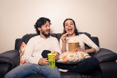 Couple having fun watching television, streaming. Film and series.. stock photography