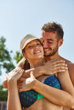 Couple laughs and hugs happily Royalty Free Stock Photo