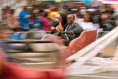 Couple Laughs Riding Scrambler Carnival Ride At Atlanta Fair stock photos