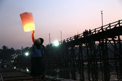 A couple launching light lantern in evening Stock Photo