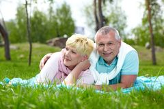 Couple on the lawn Royalty Free Stock Photo