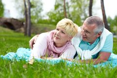 Couple on the lawn Stock Image