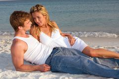 Couple Lay On Beach At Sunset Royalty Free Stock Photos