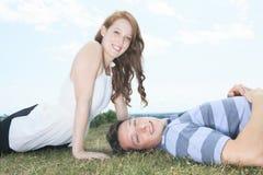 Couple lay grass Stock Photos