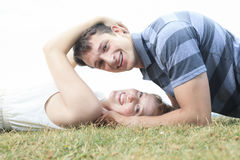 Couple lay grass Royalty Free Stock Images
