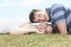 Couple lay grass Royalty Free Stock Photo
