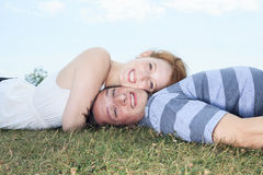 Couple lay grass Stock Photography