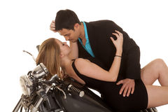 Couple lay on motorcycle faces close Royalty Free Stock Image