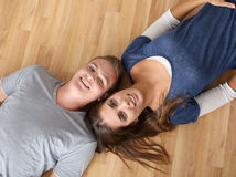 Couple laying on the floor Royalty Free Stock Photography