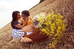Couple laying on grass having picnic Stock Image