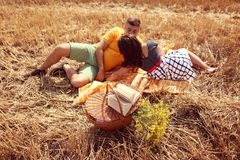 Couple laying on grass having picnic Royalty Free Stock Photos