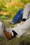 Couple laying on grass in park in autumn Royalty Free Stock Photography