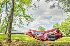 Couple laying in hammock Stock Image