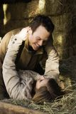 Couple laying in hay. royalty free stock photo