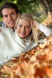 Couple laying on leaves Royalty Free Stock Images