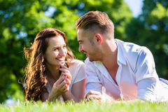 Couple laying on park Royalty Free Stock Photo