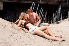 Couple laying in sand Royalty Free Stock Image