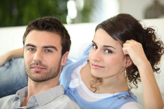 Couple laying on sofa Royalty Free Stock Photo
