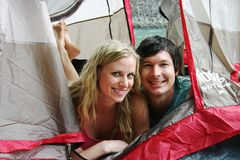 Couple laying in tent Royalty Free Stock Images