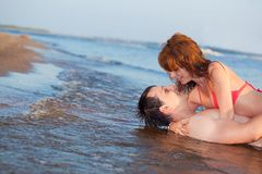 Couple laying water Royalty Free Stock Images