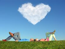 The couple lays on grass Stock Photos
