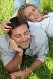 Couple lazing  on grass Stock Photos