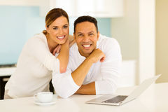 Couple leaning against counter Stock Photos