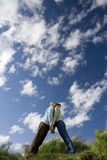 Couple leaning against each other outdoors, low angle view Stock Photography