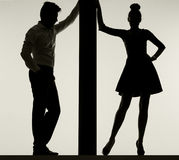 Couple leaning against the thin board Royalty Free Stock Photo