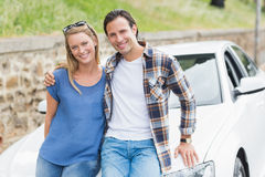 Couple leaning on the bonnet Royalty Free Stock Photography