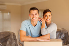 Couple leaning on boxes Stock Images