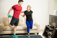 Couple leaning on each other and stretching Stock Photos