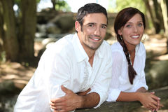 Couple leaning on a fence Royalty Free Stock Images