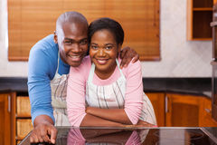 Couple leaning kitchen counter Stock Images
