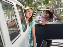 Couple Leaning Out Of Campervan During Road Trip Stock Photo