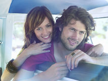 Couple Leaning On Seat Of Van Royalty Free Stock Photos