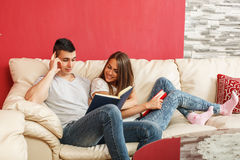 Couple learning at home Stock Photo