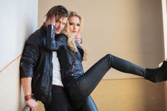 Couple in leather clothes standing embraced Stock Photos