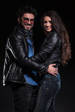 Couple in leather jacket standing embraced and smile Stock Photography