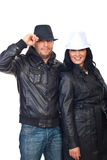 Couple in leather jackets and hats royalty free stock photo