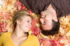 Couple in Leaves Royalty Free Stock Images