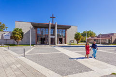 Couple leaving the mass in the Saint Adrian Mother Church, Portugal. Royalty Free Stock Photos