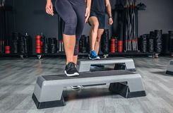 Couple legs over steppers training in aerobic Royalty Free Stock Image
