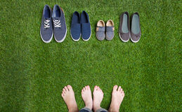 Couple legs and shoes standing  on grass Royalty Free Stock Photography