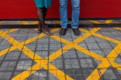 Couple legs on a tiled floor Royalty Free Stock Images