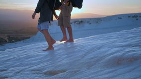 Couple legs walk down in the flowing water in Pamukkale. Couple legs walk in the thermal waters of Cotton Castle in Pamukkale Turkey stock video