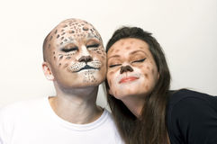 Couple leopards. Couple with painted face like leopard stock photos