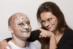 Couple leopards. Couple with painted face like leopard stock photography