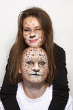 Couple leopards. Couple with painted face like leopard stock images