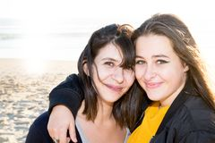 Couple lesbian girls women on sunny day at beach s. Ide stock photo